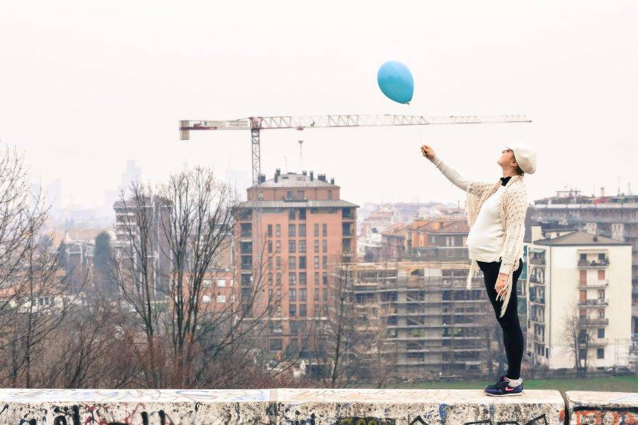 woman on roof holding balloon